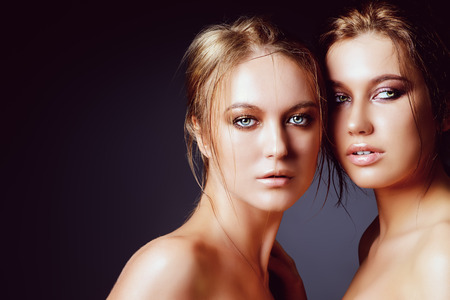 Portrait of two beautiful sensual women.