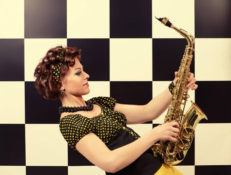 Beautiful saxophone player in retro style. Professional musician. Beat generation. Stock Photo