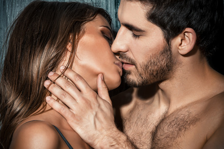 Close-up portrait of a passionate young people in love. Stock Photo - 54018199