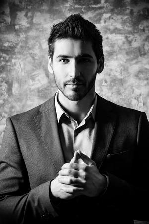 Fashion shot of a handsome man wearing elegant suit. Mens beauty, fashion. Businessman. Black-and-white portrait. Stock Photo
