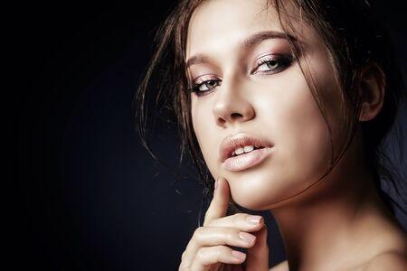Beautiful sensual woman posing over black background. Passion, desire.