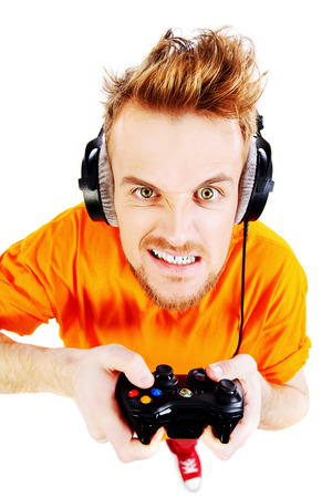 Crazy gamer with controller and headphones. Isolated over white. 版權商用圖片