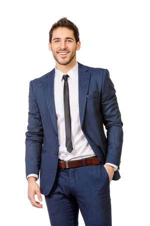 Fashion shot of a handsome man wearing elegant suit. Men's beauty, fashion. Isolated over white. Stock Photo