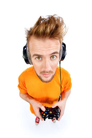 Crazy gamer with controller and headphones. Isolated over white. Stock Photo