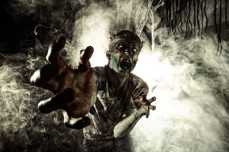 Terrible bloody zombie man  with the brains out in search of his victim. Horror. Halloween concept. Stockfoto