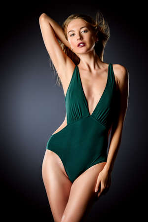Beautiful sensual woman with magnificent long hair posing in swimsuit. Beauty, fashion. Make-up. Stok Fotoğraf
