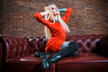 Extravagant glamorous woman with bright make-up and long blonde hair. Beauty, fashion concept. Cosmetics, make-up. 写真素材