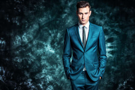 Fashion shot of a handsome young man in elegant classic suit. Mens beauty, fashion. Banco de Imagens