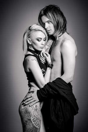 Black-and-white portrait of a beautiful sexual couple in love.