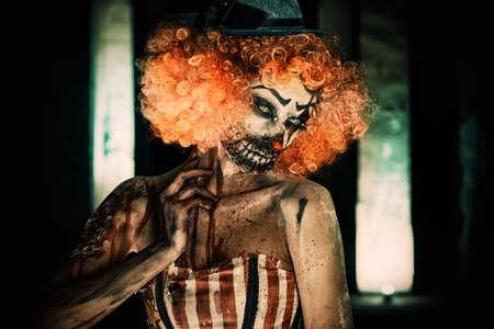 Portrait of a terrible bloody redhead clown. Halloween. Horror.