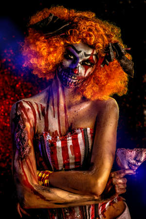 Portrait of a terrible bloody redhead clown. Halloween. Horror.