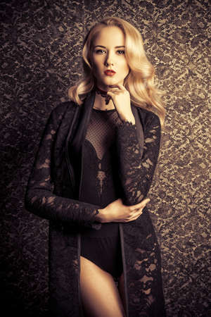 Gorgeous young woman with beautiful blonde hair posing over dark vintage  background. Make-up 8e1bcbf71