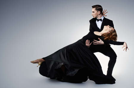 Couple of professional dancers performing tango.