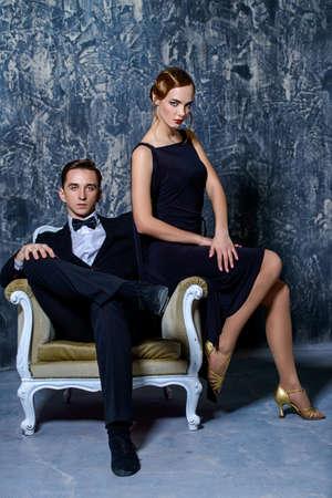 Beautiful gorgeous couple in elegant evening dresses.