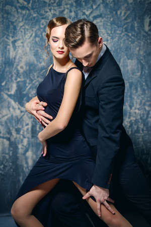 Beautiful passionate dancers dancing tango. Professional dancers. Couple in love dancing on a date. Love concept. Stock Photo