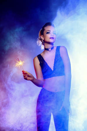 Disco, night party concept. Attractive girl dancing at a night party. Beauty, fashion. Entertainment. Stock Photo