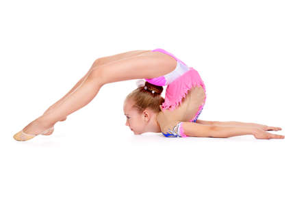 Mooi gymnast meisje doen gymnastiek. Professionele sport. Geïsoleerd dan wit. Kopieer ruimte.