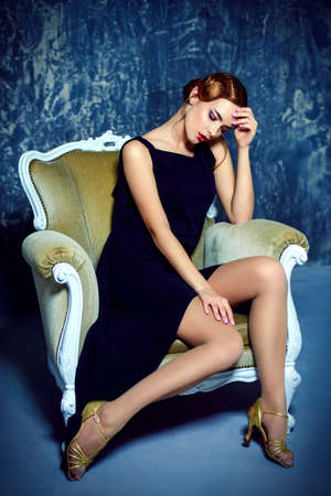 Beautiful charming woman with old fashioned make-up and finger wave hairstyle.  Luxurious life. Retro style of 20s and 30s. Beauty, fashion concept.