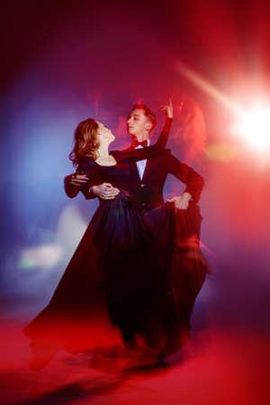 Art concept. Beautiful vigorous dancers performing tango at studio.