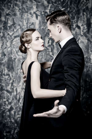 Beautiful gorgeous couple in elegant evening dresses. Fashion, glamour. Retro style.