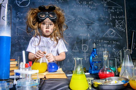 Funny little girl doing experiments in the laboratory.