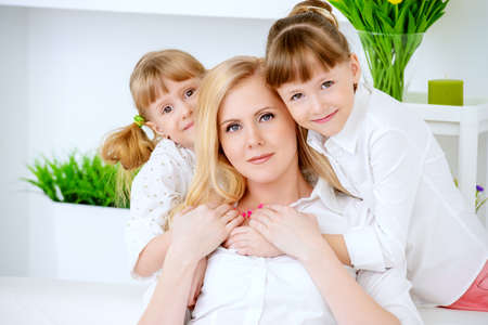 Happy family spending time together. Loving daughters with their dear mother. Banco de Imagens