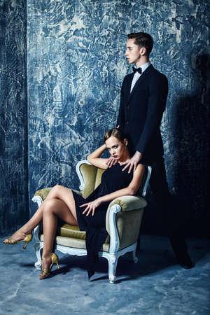 Beautiful gorgeous couple in elegant evening dresses. Fashion, glamour. Retro style.