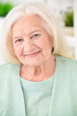 Beautiful senior woman spending time at home. Beauty, fashion. Happy retirement. Banco de Imagens