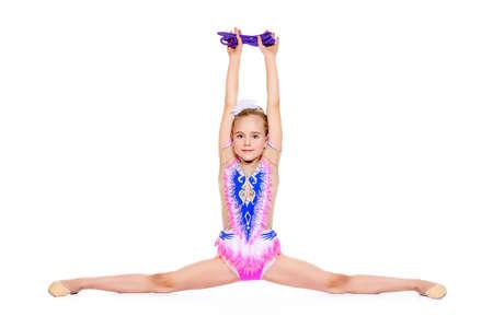 若い体操の女の子は、分割を行います。プロスポーツ。白で隔離されました。領域をコピーします。 写真素材