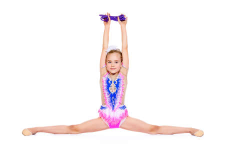 Young gymnast girl doing the splits. Professional sports. Isolated over white. Copy space. Stock fotó