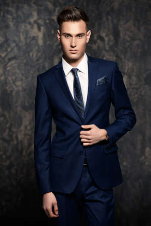 Fashion shot of a handsome young man in elegant classic suit. Mens beauty, fashion. Stock Photo