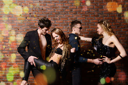 Disco, night party concept. Group of cheerful young people dancing at a night party. Beauty, fashion. Entertainment. Banco de Imagens