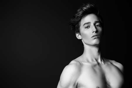 Black-and-white portrait of a sexy muscular young man over black background. Stock fotó - 79563787