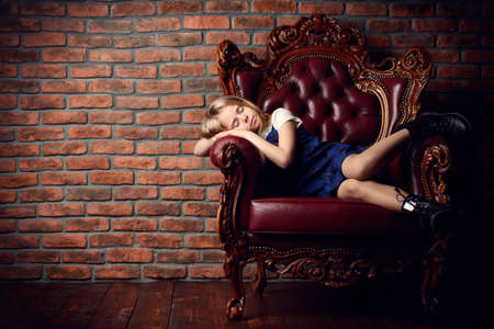Childrens fashion. Modern eight year old girl posing in vintage interior. Studio shot.
