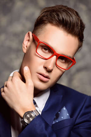 Fashion shot of a handsome young man in elegant classic suit and spectacles. Mens beauty, fashion. Stock Photo
