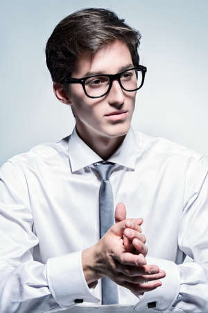 Portrait of a handsome young man posing in white shirt and a tie. Business style. Studio fashion shot. Stok Fotoğraf