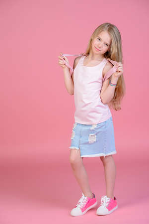 2f9ae9296cf6 Childrens fashion. Cute eight year old girl wearing summer jeans clothes  and a bag posing