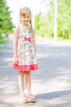 Cute little girl walking in a summer park. Stock Photo
