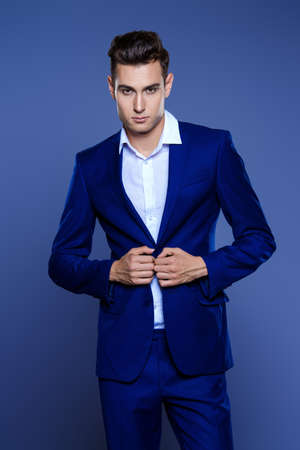 Vogue shot of a handsome male model in elegant classic suit. Mens beauty, fashion. Stock Photo