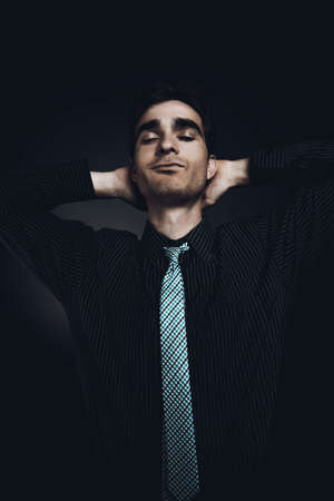 Handsome young man in a suit closed his eyes. Male beauty. Mens health. Stock Photo