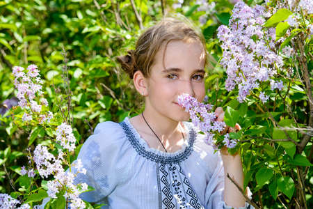Portrait of a cute girl in a summer park. Sunny day. Stock Photo