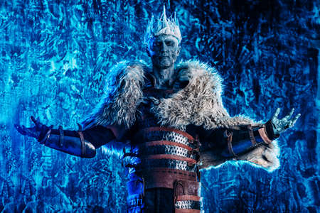 Halloween. The King zombie warrior in the armor of a medieval knight covered with snow. Horror fantasy film. Reklamní fotografie - 85271497