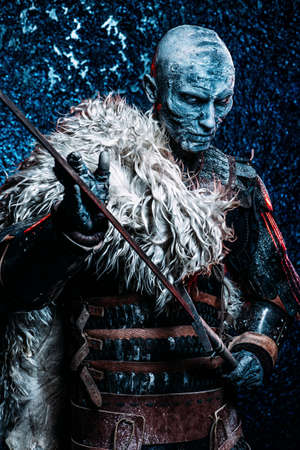 halloween frozen snow covered zombie warrior in the armor of a medieval knight stock