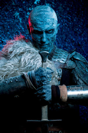 Halloween. Frozen snow covered zombie warrior in the armor of a medieval knight. Imagens - 85752805