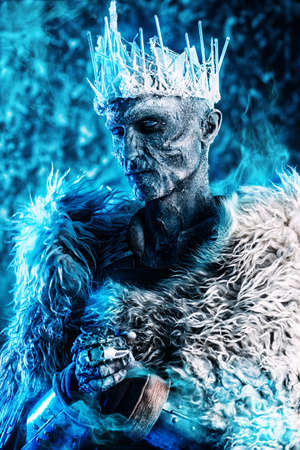Halloween. The King zombie warrior in the armor of a medieval knight covered with snow. Horror fantasy film. Stock Photo