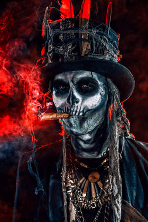 Baron Saturday. Baron Samedi. A man with a skull makeup dressed in a tail-coat and a top-hat. Dia de los muertos. Day of The Dead. Halloween. Banco de Imagens