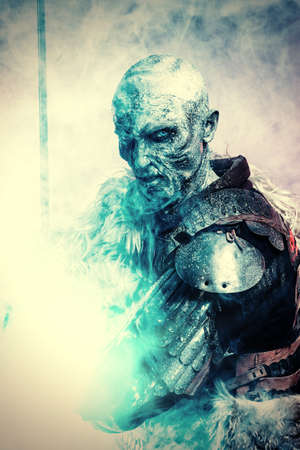 Halloween. Frozen snow covered zombie warrior in the armor of a medieval knight. Stok Fotoğraf - 85979167