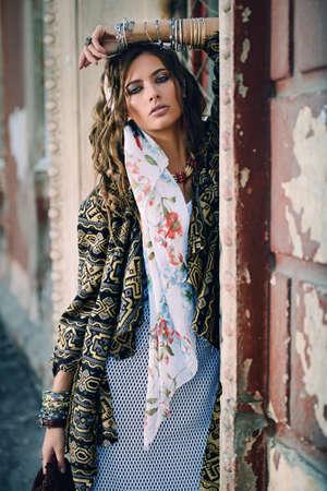 Female style. Feminine fashion model posing in boho style clothes on a street. Outdoor fashion. Stock fotó