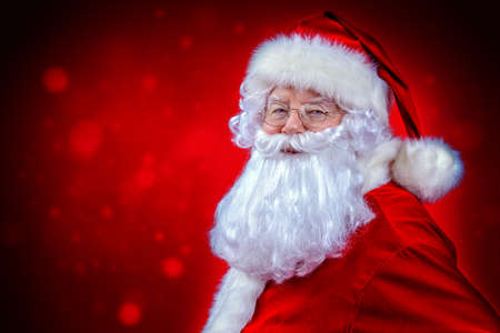 Christmas concept. Close-up portrait of a fairytale Santa Claus over red background. Good old traditions. Family holidays.