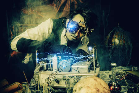 Scientist inventor steampunk works in his laboratory. Science fiction concept. Halloween. Imagens